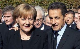 Le président français et la chancelière allemande Angela Merkel, qui se sont retrouvés samedi pour une cérémonie célébrant le général de Gaulle et le couple franco-allemand à Colombey-les-Deux-Eglises, ont refusé de fournir la moindre indication sur les décisions que pourraient prendre l'Eurogroupe dimanche.