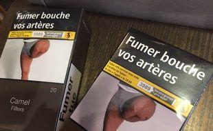 Le paquet de cigarette avec la photo de la jambe estropiée et le message «Fumer bouche vos artères».