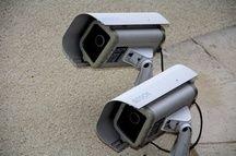 Des caméras sur la façade d'un immeuble. Illustration.