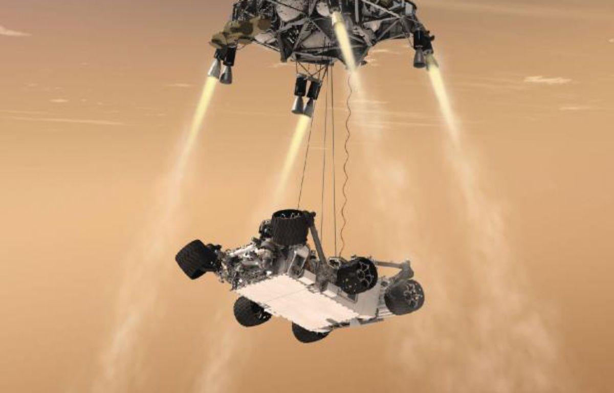 Vue d'artiste du robot Curiosity, un rover de la taille d'une voiture, qui doit être hélitreuillé jusqu'à la surface de Mars le 6 août 2012. – NASA/JPL-Caltech