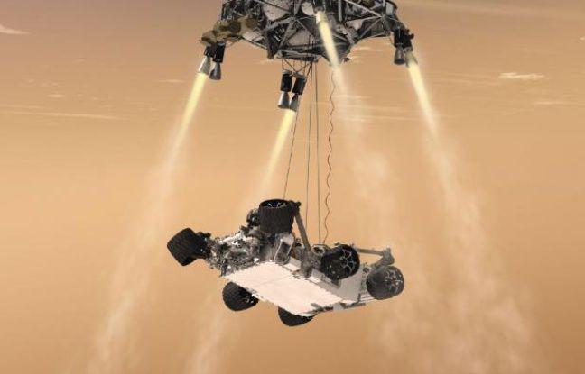 Vue d'artiste du robot Curiosity, un rover de la taille d'une voiture, qui doit être hélitreuillé jusqu'à la surface de Mars le 6 août 2012.