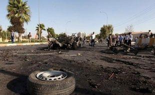Au moins 16 personnes ont été tuées jeudi soir dans un double attentat suicide contre une base militaire au nord de Bagdad, selon des sources médicales et de sécurité.