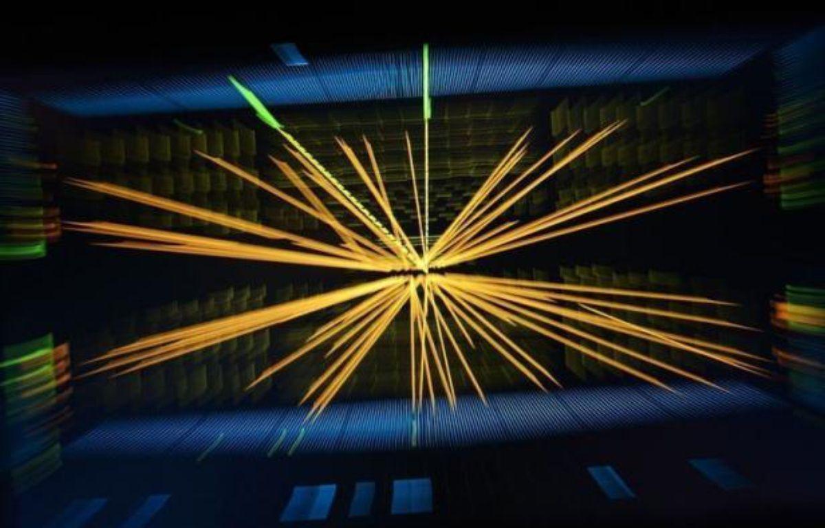 """Il est encore trop tôt pour dire qu'il s'agit bien du boson de Higgs mais les physiciens du Cern ont applaudi debout mercredi matin la découverte d'une nouvelle particule """"compatible"""" avec ce chaînon manquant de la physique des particules, qu'ils traquent depuis des décennies. –  afp.com"""