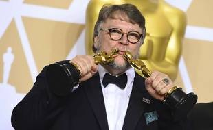"Guillermo del Toro, winner of the awards for best director for ""The Shape of Water"" and best picture for ""The Shape of Water"", poses in the press room at the Oscars on Sunday, March 4, 2018, at the Dolby Theatre in Los Angeles."