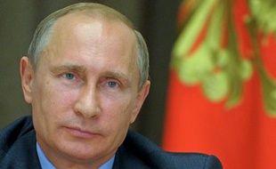 Le président russe Vladimir Poutine lors d'une vidéoconférence donnée depuis Sotchi sur le forage de pétrole dans l'océan Arctique, le 9 août 2014