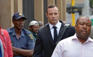L'athlète sud-africain Oscar Pistorius arrive au tribunal de Pretoria le 13 mars 2014