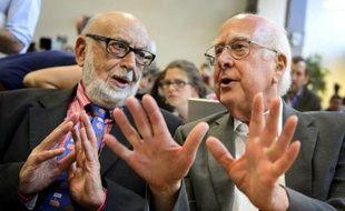 """e prix Nobel de Physique 2013 a été décerné mardi au Belge François Englert et au Britannique Peter Higgs pour leurs travaux sur le """"boson de Higgs"""", une particule élémentaire considérée par les physiciens comme la clef de voûte de la structure fondamentale de la matière."""