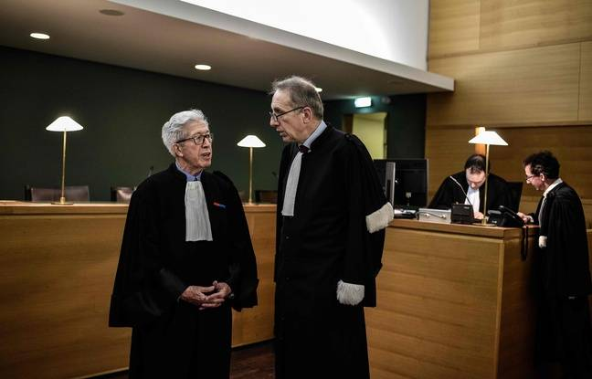 Lyon's Roman Catholic Cardinal Philippe Barbarin's lawyers Andre Soulier (L) and Jean-Felix Luciani (R) speaks on April 4, 2018 in Lyon's courtroom, on the opening day of the trial for Barbarin and other religious leaders for failing to denounce sexual assaults committed against minors. / AFP PHOTO / Jeff PACHOUD