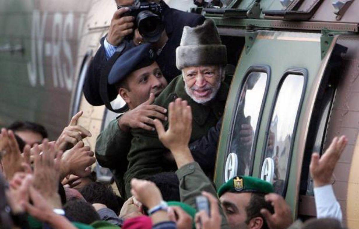Les juges enquêtant sur la thèse d'un possible empoisonnement de Yasser Arafat ont demandé à se rendre à Ramallah, où est inhumé l'ex-dirigeant palestinien et où des policiers français réaliseront des prélèvements, a annoncé dans un communiqué sa veuve, Souha Arafat. – Odd Andersen afp.com
