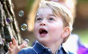 VICTORIA, BC - SEPTEMBER 29: Prince George of Cambridge plays with bubbles at a children's party for Military families during the Royal Tour of Canada on September 29, 2016 in Victoria, Canada. Prince William, Duke of Cambridge, Catherine, Duchess of Cambridge, Prince George and Princess Charlotte are visiting Canada as part of an eight day visit to the country taking in areas such as Bella Bella, Whitehorse and Kelowna PH