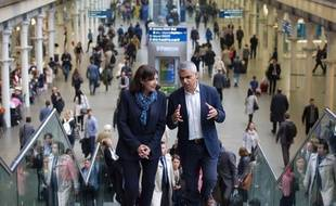 Mayor of London Sadiq Khan (L) speaks with Mayor of Paris Anne Hidalgo as they meet at St Pancras Station in London on May 10, 2016.  / AFP PHOTO / JUSTIN TALLIS