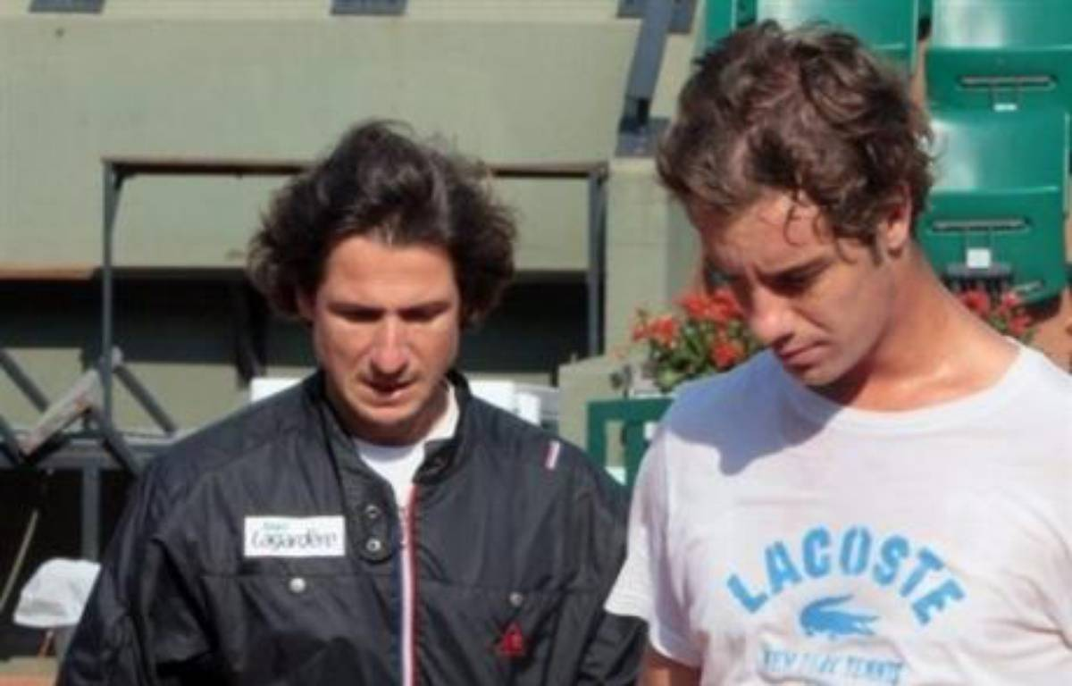 Richard Gasquet, Amélie Mauresmo et Marion Bartoli font leur entrée en lice lundi à Roland-Garros les bagages plein d'incertitudes après plusieurs semaines d'infortunes. – Jacques Demarthon AFP/Archives