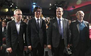 Francois de Rugy (g), Jean-Vincent Placé (2e g), Jean-Luc Bennahmias (d) et Jean-Christophe Cambadélis lors du congrès fondateur de l'UDE à Paris, le 17 octobre 2015