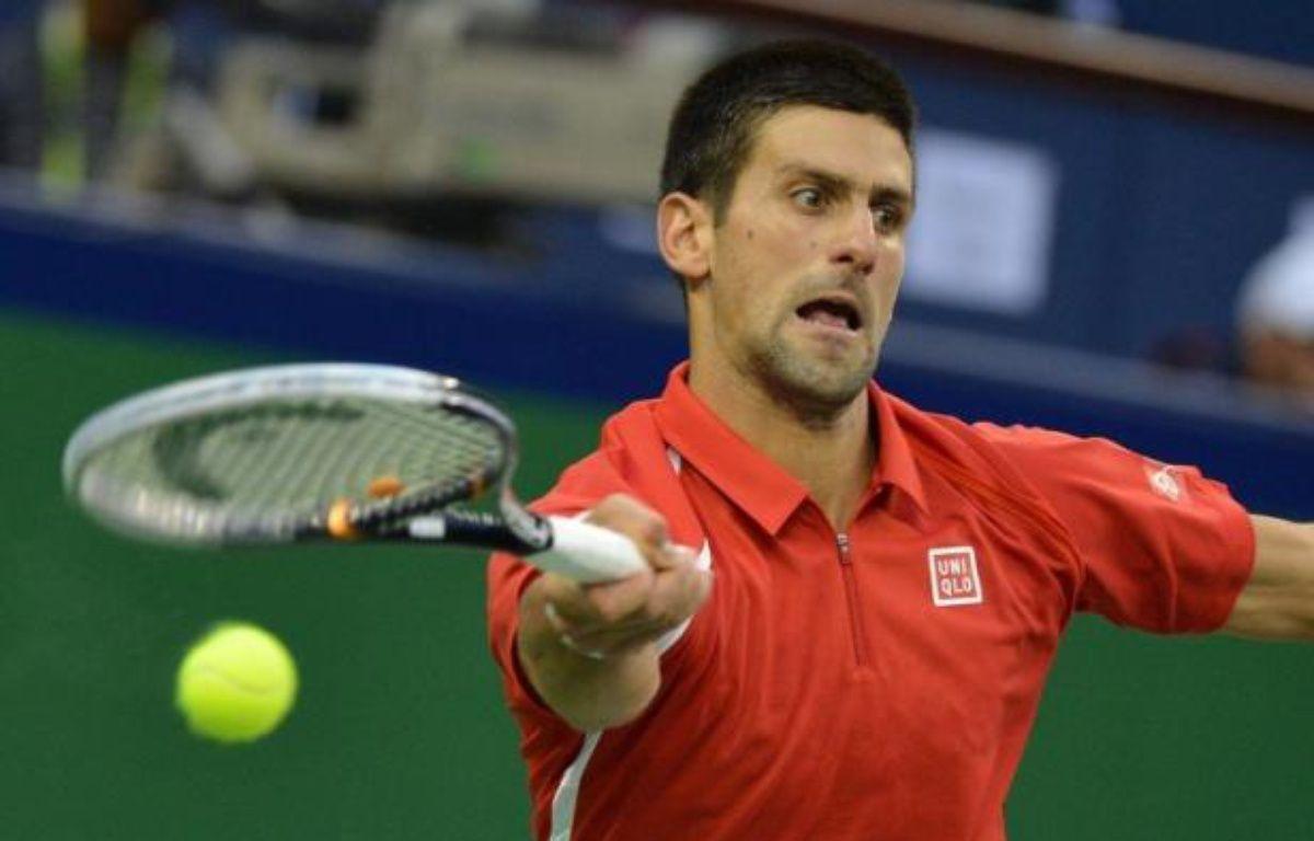 Novak Djokovic a pris place comme à son habitude en finale d'un Masters 1000, en démolissant consciencieusement le Tchèque Tomas Berdych en deux sets 6-3, 6-4, en demi-finale samedi à Shanghai – Mark Ralston afp.com