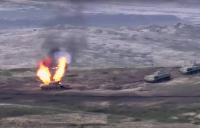 In this image taken from a footage released by Armenian Defense Ministry on Sunday, Sept. 27, 2020, Armenian forces destroy Azerbaijani tank at the contact line of the self-proclaimed Republic of Nagorno-Karabakh, Azerbaijan. Fighting between Armenia and Azerbaijan has broken out around the separatist region of Nagorno-Karabakh and the Armenian Defense Ministry says two Azerbaijani helicopters have been shot down. Ministry spokeswoman Shushan Stepanyan also said Armenian forces hit three Azerbaijani tanks. (Armenian Defense Ministry via AP)/XAZ106/20271317377124/AP PROVIDES ACCESS TO THIS PUBLICLY DISTRIBUTED HANDOUT PHOTO PROVIDED BY ARMENIAN DEFENSE MINISTRY PRESS SERVICE; MANDATORY CREDIT./2009271044