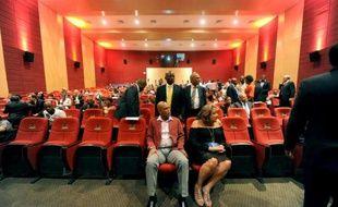Le président haïtien Michel Martelly (c) avec sa femme Sophia, lors de la réouverture du ciné-théâtre Triomphe, le 19 juin 2015 à Port-au-Prince