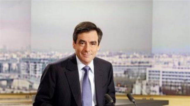 """Le Premier ministre François Fillon a annoncé lundi """"l'intégration de mesures d'économies liées à la réforme de l'Etat"""" au budget 2009. – François Guillot AFP"""