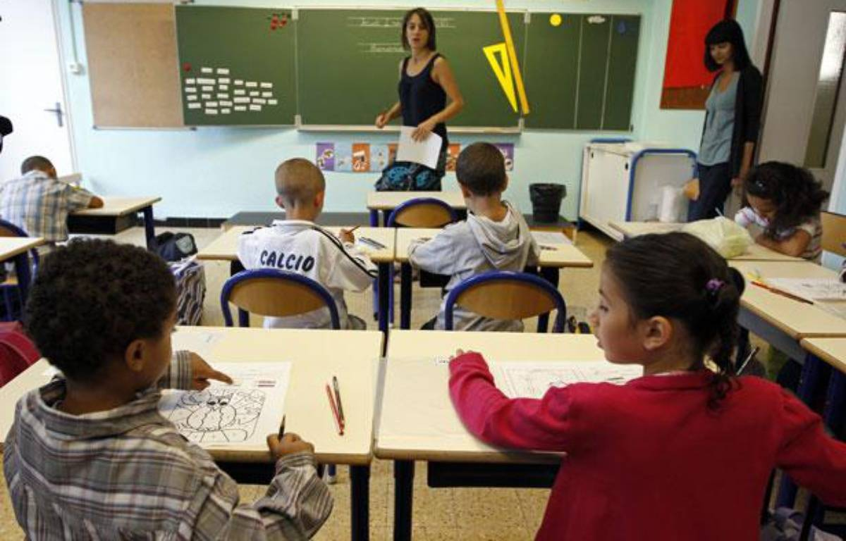 Des élèves dans une classe de primaire à Marseille, le 2 septembre 2010.  –  REUTERS/Jean-Paul Pelissier