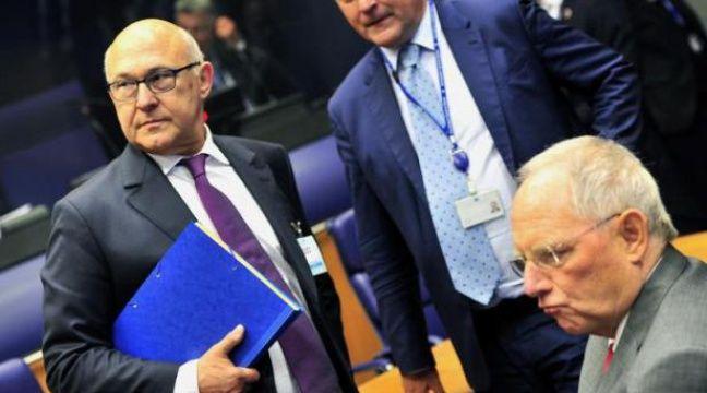 Le ministre français des Finances Michel Sapin (g) et son homologue allemand Wolfgang Schauble à une réunion de l'Eurogroupe le 19 juin 2014 au siège de l'Uion européenne au Luxembourg – Georges Gobet AFP