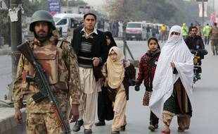 Pakistani parents escort their children outside a school attacked by the Taliban in Peshawar, Pakistan, Tuesday, Dec. 16, 2014. Taliban gunmen stormed a military-run school in the northwestern Pakistani city of Peshawar on Tuesday, killing and wounding scores, officials said, in the highest-profile militant attack to hit the troubled region in months. (AP Photo/B.K. Bangash)/BKB102/761309588222/1412161334
