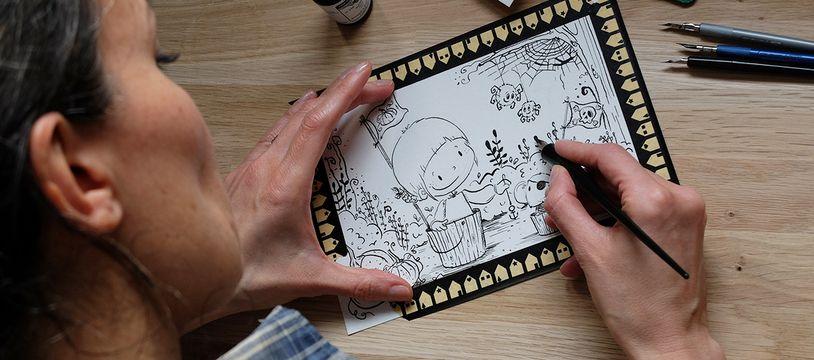 Anne, alias Kalon Sardin, est une illustratrice jeunesse installée dans le Finistère.
