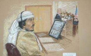 """L'ex-chauffeur de Oussama ben Laden, Salim Ahmed Hamdan, a été déclaré coupable mercredi à Guantanamo de """"soutien matériel au terrorisme"""" par un tribunal militaire d'exception qui a rejeté l'accusation de """"complot"""", à l'issue d'un procès pas exempt de critiques."""