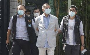 Jimmy Lai, patron de presse et figure de la contestation contre Pékin, lors de son arrestation à Hong Kong, le 10 août 2020.