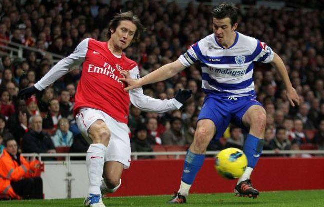 Joey Barton (à droite), contre Arsenal, le 31 décembre 2011, à l'Emirates Stadium.