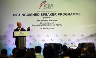 """Yukiya Amano, director general of the International Atomic Energy Agency, delivers a lecture in Singapore on January 26, 2015. Amano spoke on """"Atoms for Peace in the 21st Century"""" at the lecture organised by Energy Market Authority (EMA) .   AFP PHOTO / ROSLAN RAHMAN"""