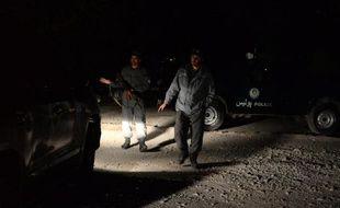 Des forces de sécurité afghanes sur les lieux d'un attentat à Kaboul, le 29 novembre 2014