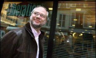 """Comme il s'y était engagé, le nouveau PDG Laurent Joffrin a recherché un """"point intermédiaire"""" entre la centaine de suppressions d'emplois réclamées par l'actionnaire principal Edouard de Rothschild, et les 66 proposées par la Société civile des personnels de Libération (SCPL, deuxième actionnaire)."""