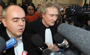 Jérôme Boursican (G) et Jean-Yves Liénard, avocats de l'ancien homme  d'affaires Christophe Rocancourt, répondent aux questions des  journalistes le 17 février 2012