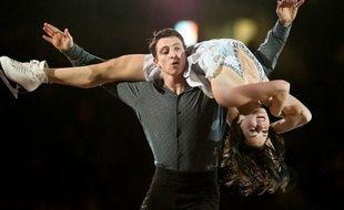 Les Canadiens Tessa Virtue et Scott Moir, champions olympiques en titre, ont remporté l'épreuve de danse sur glace du Skate Canada, deuxième des six étapes du Grand Prix de patinage artistique, dimanche à Mississauga (Ontario), près de Toronto.