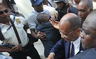 L'ancien président d'Haïti Jean-Bertrand Aristide a été entendu mercredi pendant deux heures comme témoin dans l'enquête sur l'assassinat d'un journaliste en 2000, l'occasion pour ses partisans de manifester aux portes du tribunal.