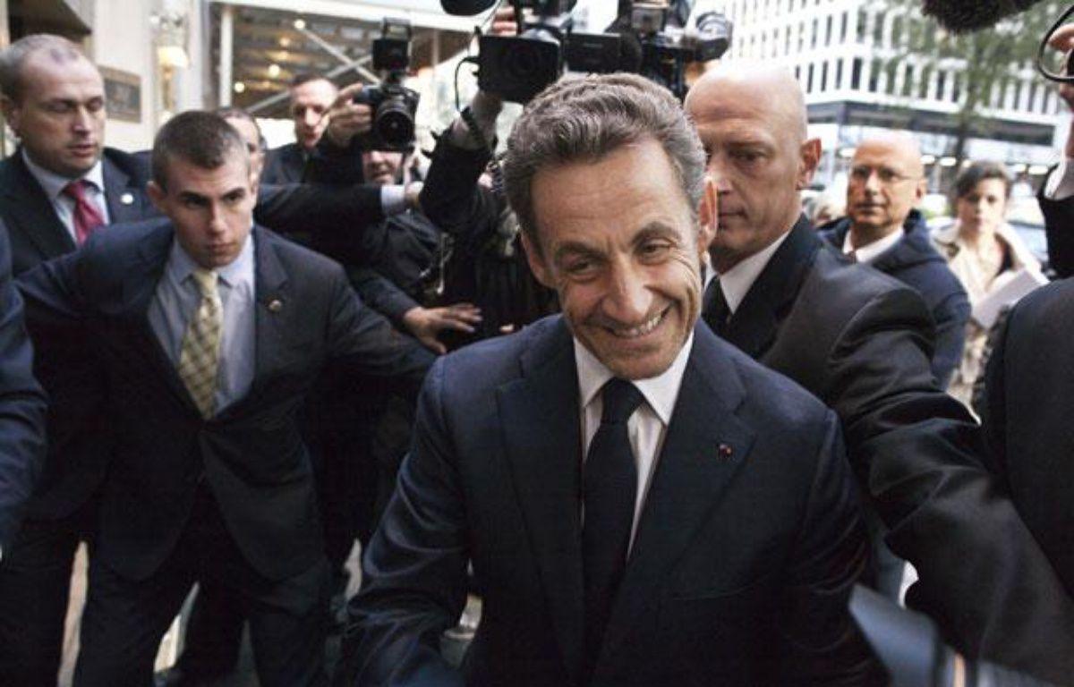 Nicolas Sarkozy lors de son arrivée dans un grand hôtel de New York afin d'y donner une conférence, le 11 octobre 2012. – A.KELLY / REUTERS