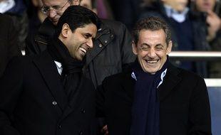 Nicolas Sarkozy en compagnie du président du PSG Nasser Al-Khelaïfi, en novembre 2014, au Parc des Princes.