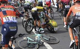Netherlands' Dylan Groenewegen, center right, is comforted by teammate New Zealand's George Bennett, after he crashed during the first stage of the Tour de France cycling race over 194.5 kilometers (120,86 miles) with start in Brussels and finish in Brussels, Saturday, July 6, 2019.