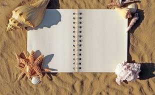 Cahier sur la plage