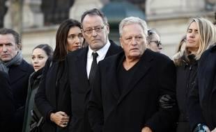 André Boudou, à côté de Jean Reno, lors des obsèques de Johnny Hallyday.