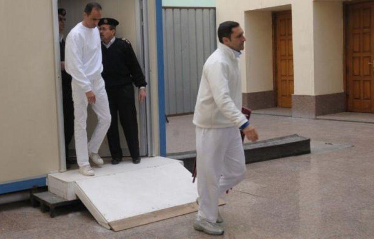 Les deux fils du président égyptien déchu Hosni Moubarak, déjà jugés pour malversations, sont sous le coup d'un nouveau procès pour corruption, a annoncé mercredi la télévision d'Etat. – Str afp.com