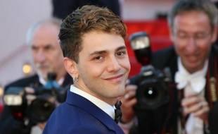 """Le jeune réalisateur canadien Xavier Dolan, auteur du film """"Mommy"""" à son arrivée au palais des Festivals à Cannes pour la remise des prix du palmarés le 24 mai 2014"""