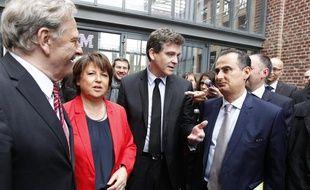 Lille, le 24 juin 2013. Arnaud Montebourg, ministre du redressement productif, était en déplacement sur le site d'Euratechnologies en compagnie de Martine Aubry pour annoncer l'implantation du géant américain de l'informatique IBM, représenté par Alain Benichou, président d'IBM France.