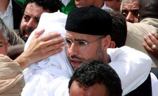 L'un des fils de Mouammar Kadhafi, Seif al-Islam, lors des funérailles de son frère, Seif al-Arab, le 2 mai 2011 à Tripoli (Libye).