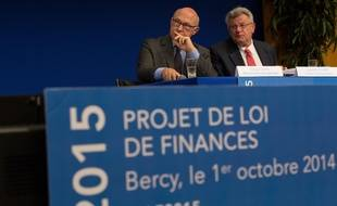 French Finance Minister Michel Sapin(L) and French Junior Budget Minister Christian Eckert presented the draft Finance Bill 2015.