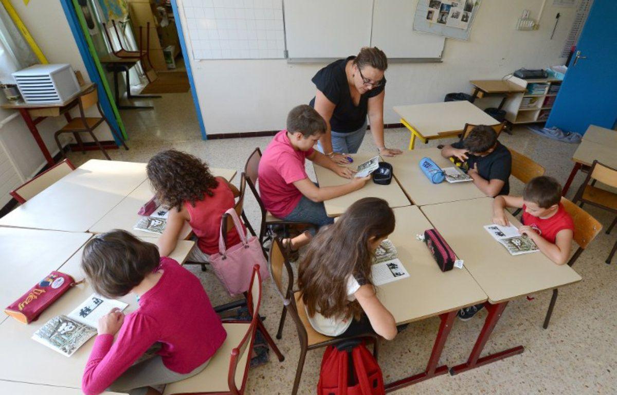 Des écoliers dans une école élémentaire Plan de la Cour, à Vitrolles, en 2012. – GERARD JULIEN / AFP