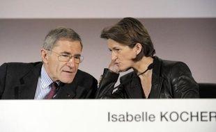 Le Pdg de GDF Suez Gérard Mestrallet et Isabelle Kocher, nommée directrice générale déléguée et administrateur du groupe, le 27 février 2014 à Paris