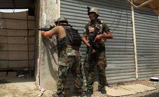 L'armée afghane combat les talibans à Kandahar, le 23 juillet 2021.