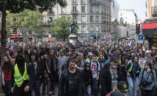 Des manifestants à Paris le 1er mai.