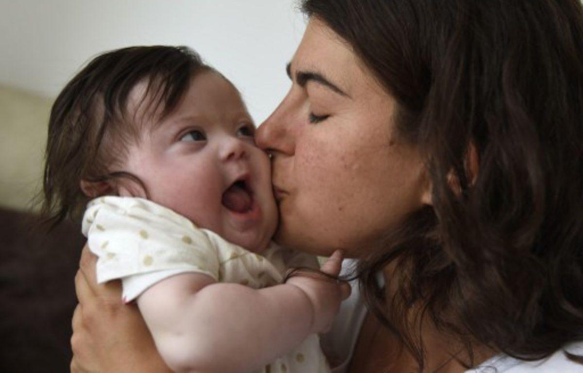 Caroline Boudet et sa fille Louise le 11 juin 2015.  – DOMINIQUE FAGET / AFP
