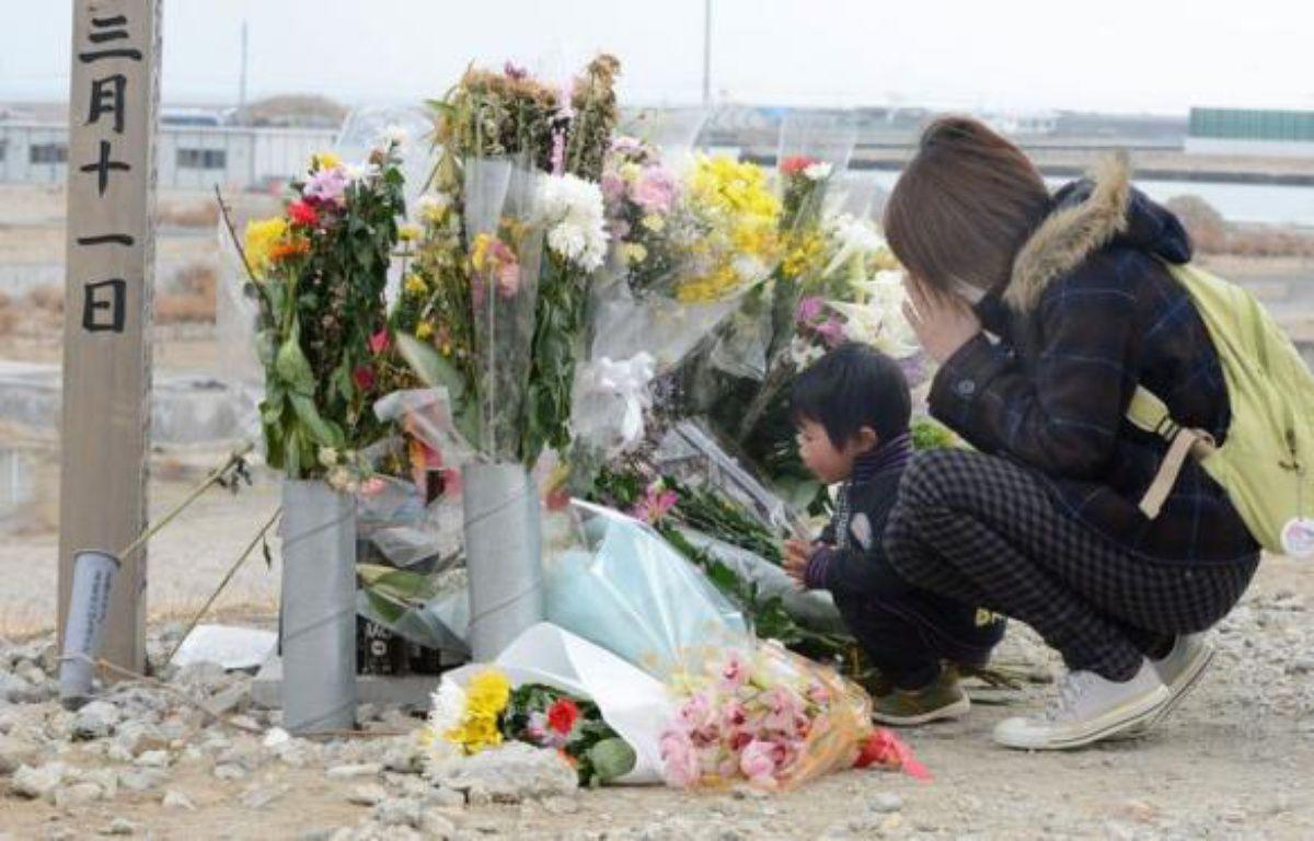 Le Japon va se figer le 11 mars pour se souvenir du terrible tsunami dans la région du Tohoku et constater l'immensité des chantiers hérités de cette catastrophe historique qui a fait près de 19.000 morts il y a deux ans. – Toru Yamanaka AFP